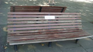 The plaque AND bench